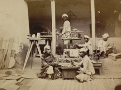 Mistri Moolchand, watchmaker and mechanic to the Maharaja of Benares, teaching his son in his own house, Varanasi (Benares)